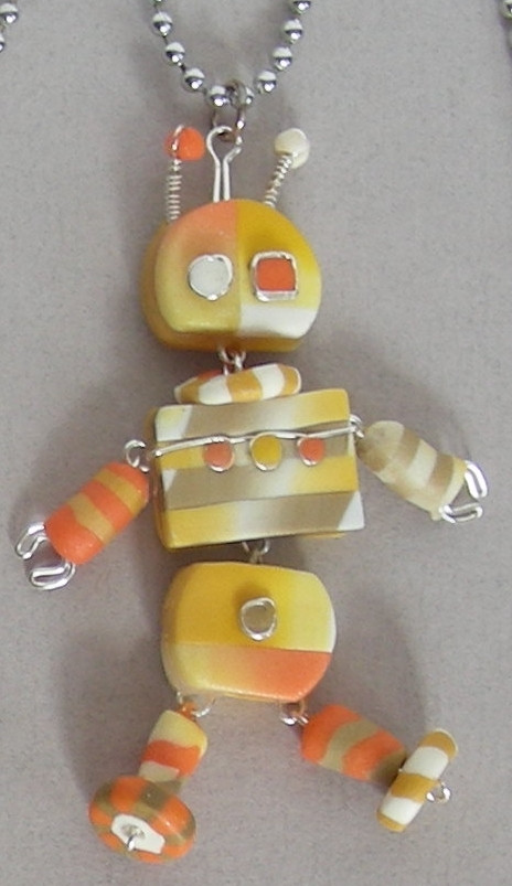 image of dancing robot, handmade from colored polymer clay and stainless wire
