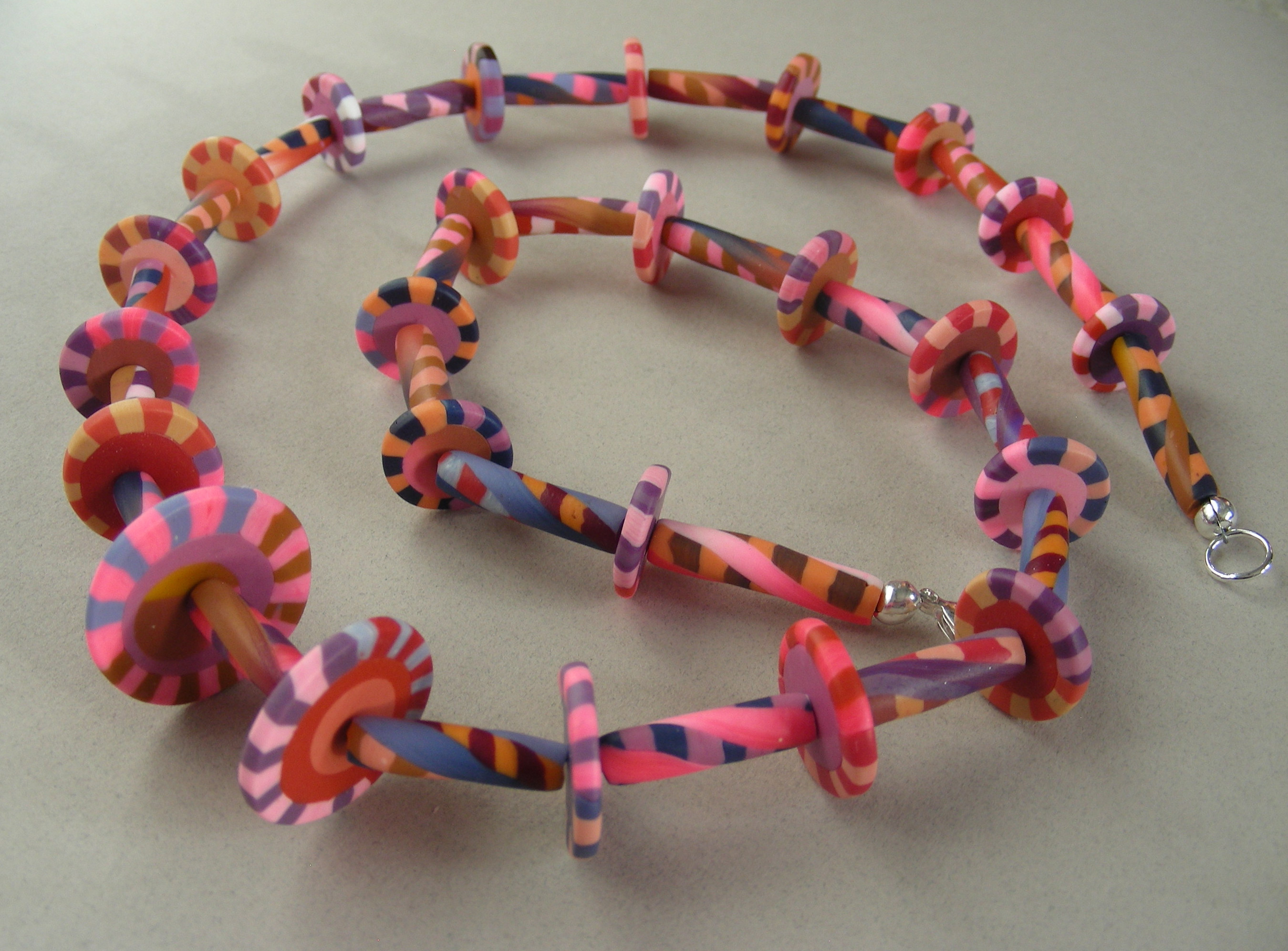 image of handmade pink, polymer necklace